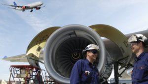 Airline Maintenance Crew Works on Plane