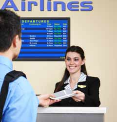 Airport Desk Attendant Checking in Passenger