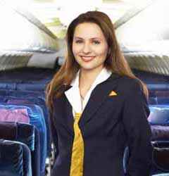Female Flight Attendant Smiles for Photo